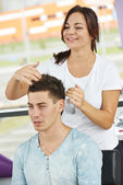 Male hairdresser at work — Stock Photo