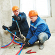 Engineer repairmen installing heating system — Stock Photo