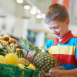 Child shopping at supermarket — Stock Photo #44106015