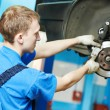 Auto mechanic at car brake shoes replacement — Stock Photo