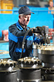Industrial assembler worker at factory — Стоковое фото