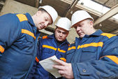Industrial workers on house building plant — Stock Photo