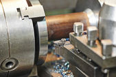 Metal machining by turning on lathe — Stock Photo
