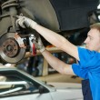 Auto mechanic at car brake shoes replacement — Stock Photo #44958701