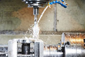 Drilling process of metal on machine tool — Stock Photo