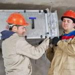 Heating engineer repairman in boiler room — Stock Photo #45667087