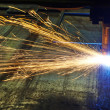 Laser or plasma cutting of metal sheet with sparks — Stock Photo #45667193