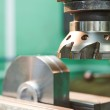 Close-up process of metal machining by mill — Stock Photo #45669049
