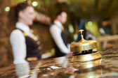 Hotel reception with bell — Stock Photo