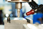 Process of metal machining by mill — Stock Photo
