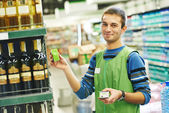 Shopping seller in supermarket — Stock Photo