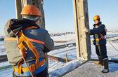 Builder worker installing concrete panel — Stock Photo