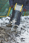 Construction road works with jack hammer — Stock Photo