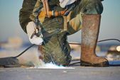 Welder at construction site — Stock Photo