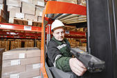 Warehouse worker with scanner — Stock Photo