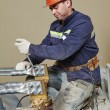 Power electrician lineman at work — Stock Photo #45999879