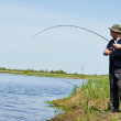 Fisher fishing fish with rod — Stock Photo #46000351