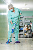 Woman cleaning hospital hall — Stock Photo