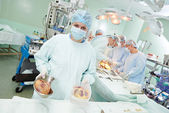 Surgeons nurse at cardiac surgery operation — Stock Photo