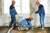 Plasterers concrete worker at floor work — Stock Photo