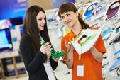 Woman shopping at home appliance supermarket — Stock Photo