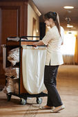 Chambermaid at hotel — Stock Photo