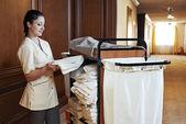 Chambermaid at hotel — Stock Photo