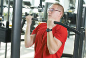 Man doing exercises at fitness gym — Stock Photo