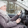 Woman driving a car looking forward — Stock Photo #12200224