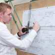 Engineer making a blueprint project with old-fashioned drawing board — Stock Photo