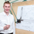 Handsome engineering worker with pencil in the workplace near panel board — Stock Photo #13260415