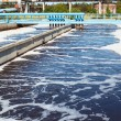 Stock Photo: Water treatment tank with waste water with aeration process