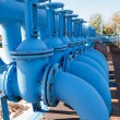 Royalty-Free Stock Photo: Line from blue oxigen gate valves with pipes on maintenance platform