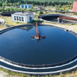 Stock Photo: Top view on round form water treatment primary radial settler
