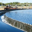 Stock Photo: Water overflow from big sedimentation settler round