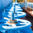 Line from blue vents of oxigen gate valves — Stock Photo #13260579