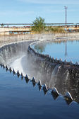 Owerflowing sewage from radial sedimentation tank — Stock Photo
