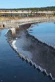 Drainage in sedimentation reservoir with clean water overflowing — Stock Photo