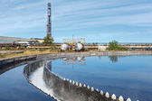Clean blue water overflowing from sedimentation tanks — Stock Photo
