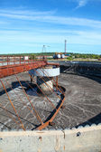 Empty huge round form sedimentation settler tank in treatment plant — Stock Photo