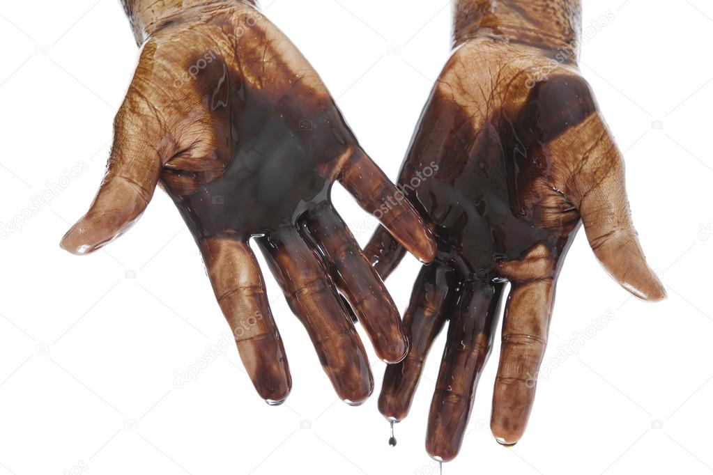 Oil in dirty hands isolated  Stock Photo #13260590