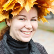 Portrait of happy young womwith maple wreath — Stock Photo #14902949