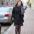 Fashion womfull-length portrait in streets of city — Stock Photo #14903011