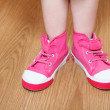 Children legs in pink shoes — Stock Photo