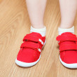 Children legs in wrong feet shoes — Stock Photo