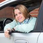 Happy woman in car window — Stock Photo