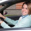 Foto Stock: Beautiful womholding steering wheel in car