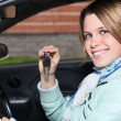 Close up portrait of female driver with car key in hand — Stock Photo