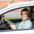 Young woman fastening in car — Stock Photo #14903717