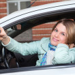 Ignition key in hand of female in car — Stock Photo